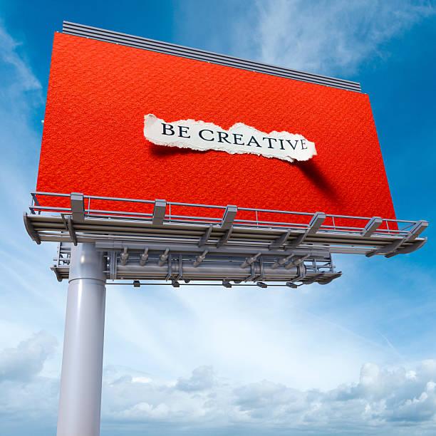 Be creative billboard red stock photo