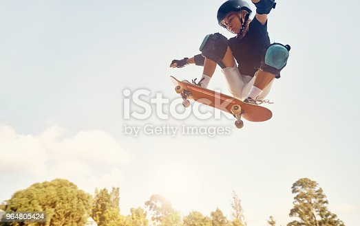 Shot of a young girl skateboarding at a skatepark