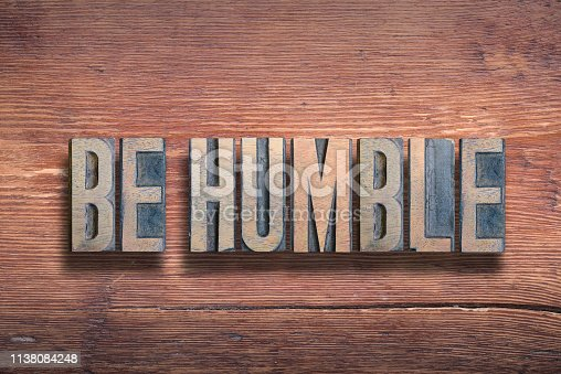 be humble phrase combined on vintage varnished wooden surface