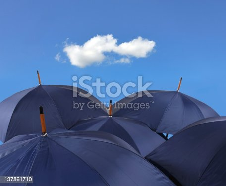 Five navy blues open large umbrellas, small white  cloud, blue, bright sky