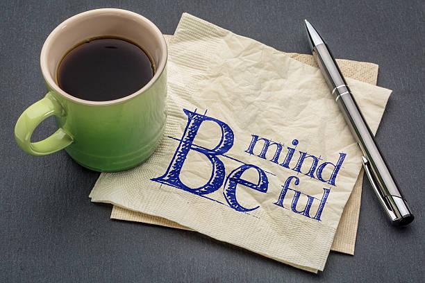 Be mindful note on napkin stock photo