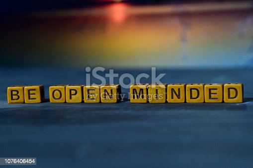 istock Be open minded on wooden blocks. 1076406454