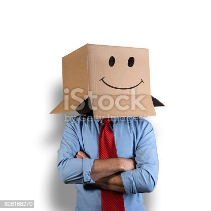 Businessman hiding his head in a cardboard box. There is a smile symbol drawn on the box with a black marker