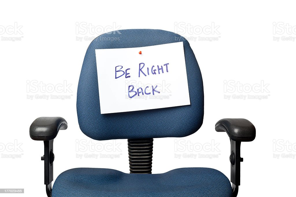 Be right back sign pinned to blue office chair royalty-free stock photo