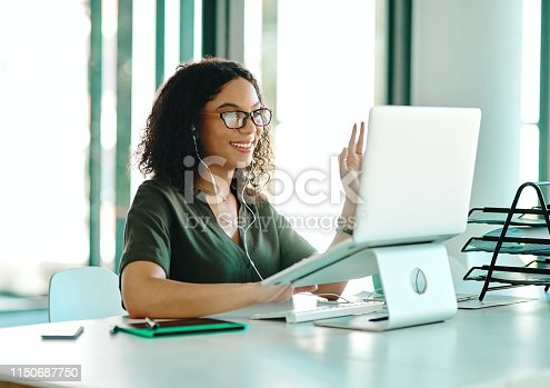 Shot of a businesswoman on a video call while sitting at her desk