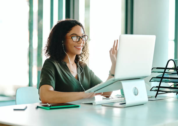 Be so good that you'll be recognized internationally Shot of a businesswoman on a video call while sitting at her desk zoom stock pictures, royalty-free photos & images