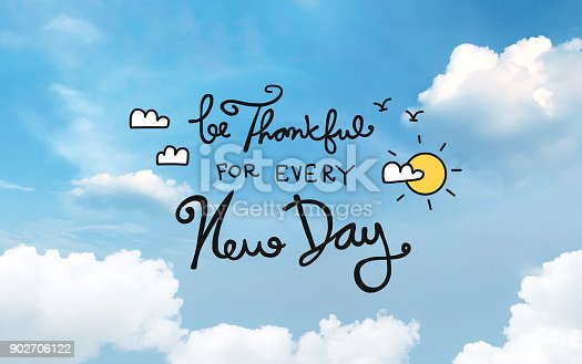 istock Be Thankful for every new day on blue sky background 902706122