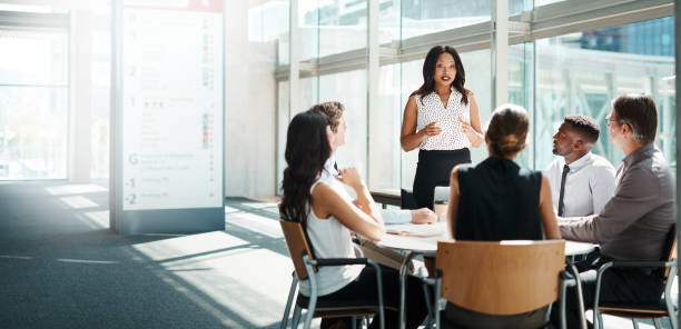 Be the leader when all others are following Shot of a group of businesspeople having a meeting in a modern office collaboration stock pictures, royalty-free photos & images