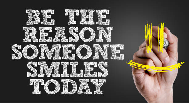 be the reason someone smiles today - charity and relief work stock pictures, royalty-free photos & images