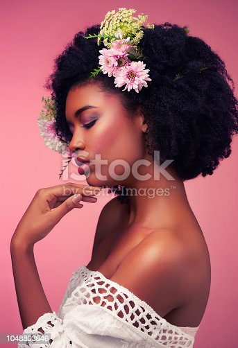 Studio shot of a beautiful young woman posing with flowers in her hair