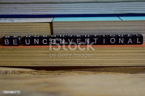 istock Be unconventional on wooden blocks 1054084772
