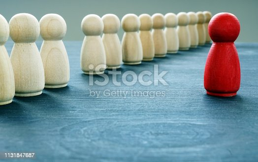 Be unique and different. Red figurine is stand out from the crowd.