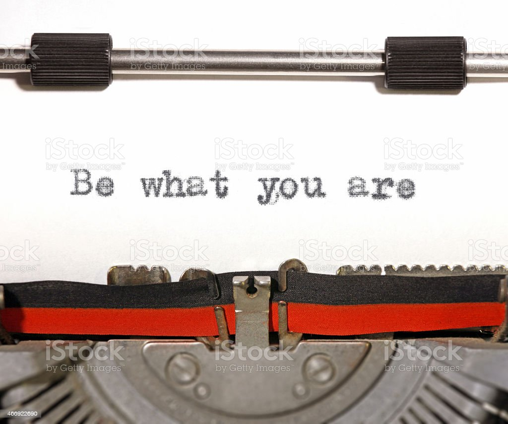 Be what you are: motivational quote old typewriter machine stock photo