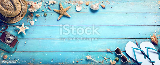 istock Beach Accessories Hat And Sandals With Seashells On Wooden Plank - Summer Holidays 958039352