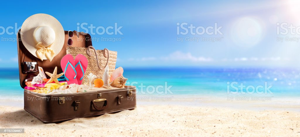 Beach Accessories In Suitcase On Beach - Travel Concept - foto de acervo