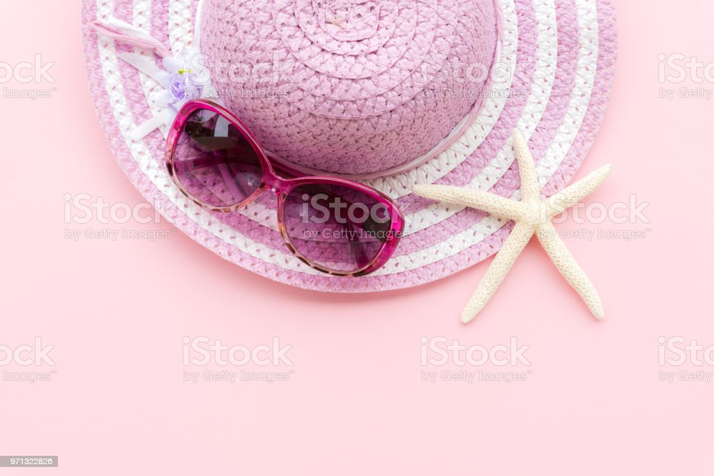 Beach accessories including starfish, pink sunglasses and purple...