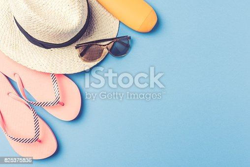 istock Beach accessories on blue background 825375836