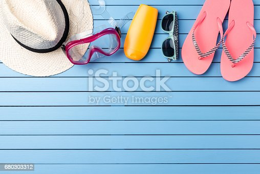 istock Beach accessories on blue wooden table. 680303312