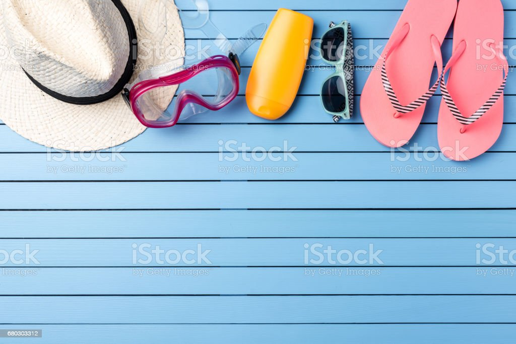 Beach accessories on blue wooden table. stock photo