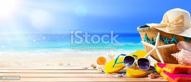 istock Beach Accessories On Table On Beach - Summer Holidays 674650538