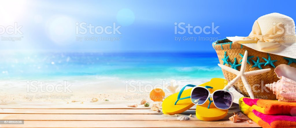 Beach Accessories On Table On Beach - Summer Holidays - foto stock