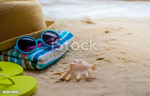 699960484 istock photo Beach Accessories On Table On Beach - Summer Holidays 969579908