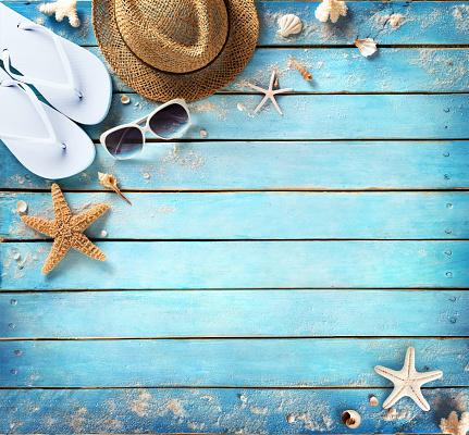 istock Beach Accessories On Vintage Blue Plank 543339478