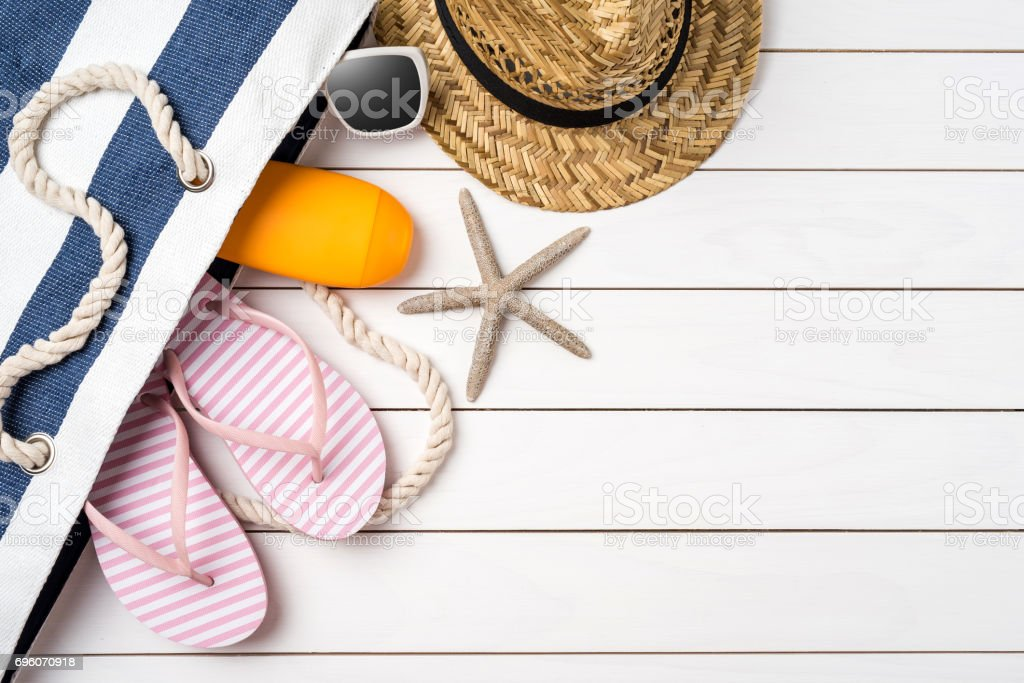 Beach accessories on white wooden table. stock photo