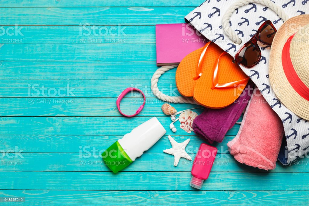 Beach accessories on wooden table. stock photo