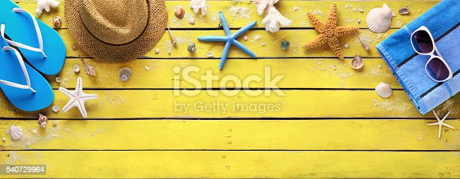istock Beach Accessories On Yellow Wooden Plank - Summer Colors 540729964