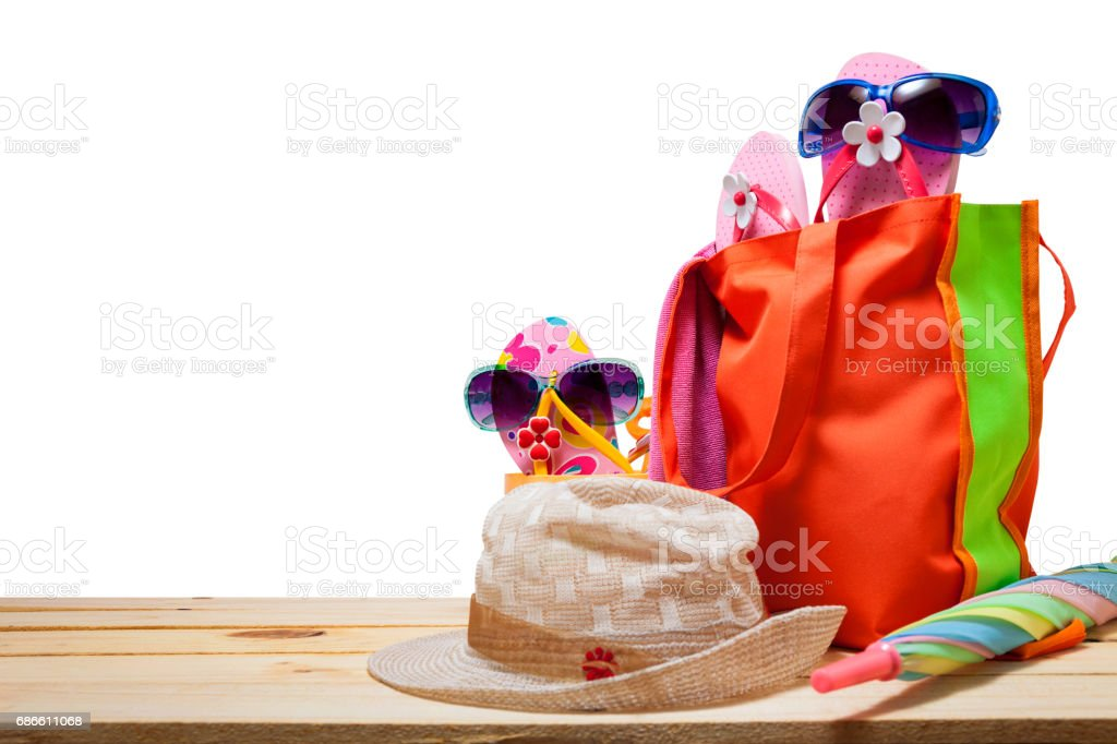 Beach accessory,hat,sunglasses,shoes,umbrella on wooden, concept summer holiday background and summer sale. royalty-free stock photo