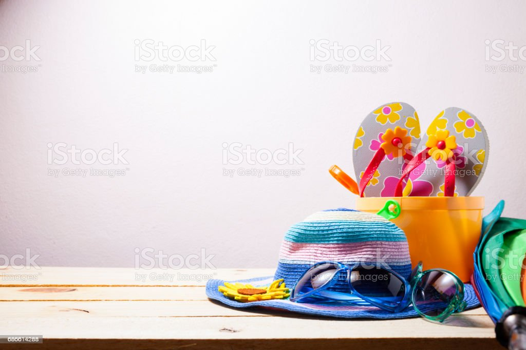 Beach accessory,hat,sunglasses,shoes,umbrella on wooden, concept summer holiday background. royalty-free stock photo