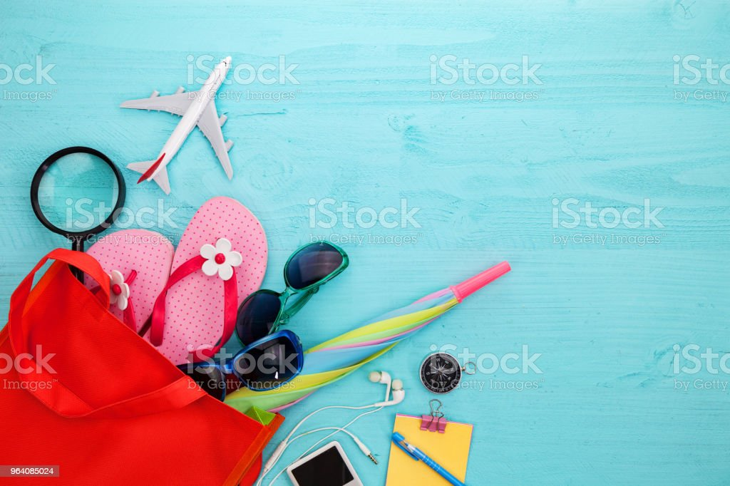 Beach accessory,hat,sunglasses,shoes,umbrella,airplane model,earphone,compass on blue wooden background, concept summer holiday travel background and summer sale - Royalty-free Air Vehicle Stock Photo