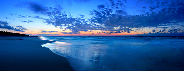 Beach after sunset - Long exposure panorama stock photo