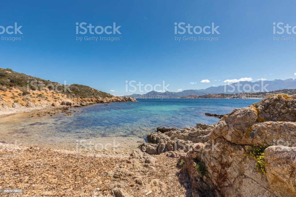 Beach and and rocky coastline at Revellata in Corsica royalty-free stock photo