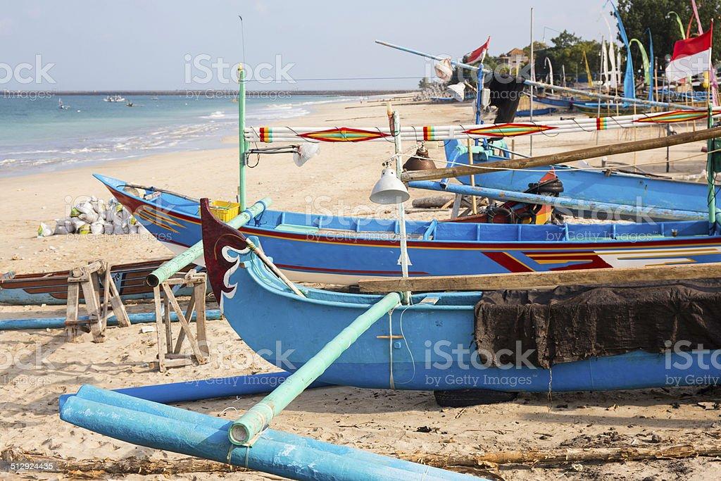 Beach and fishing boats in Jimbaran, Bali stock photo