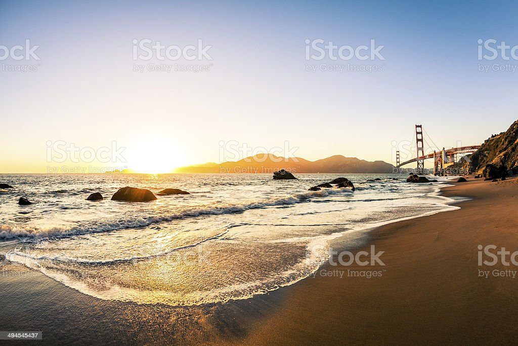 Beach and Golden Gate Bridge at Sunset in San Francisco stock photo