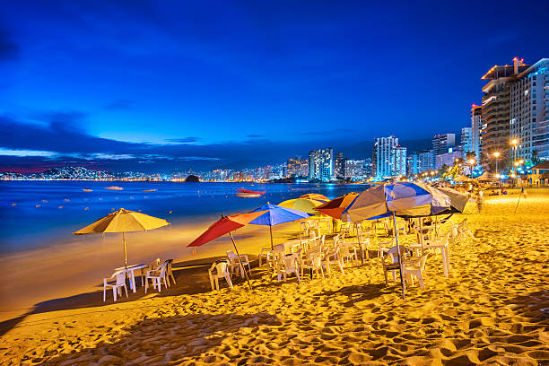 Beach and Hotels in Acapulco Mexico in the Evening stock photo