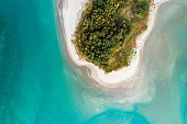 Aerial view of Waiwera River, near to Waiwera thermal pools in Auckland, New Zealand.
