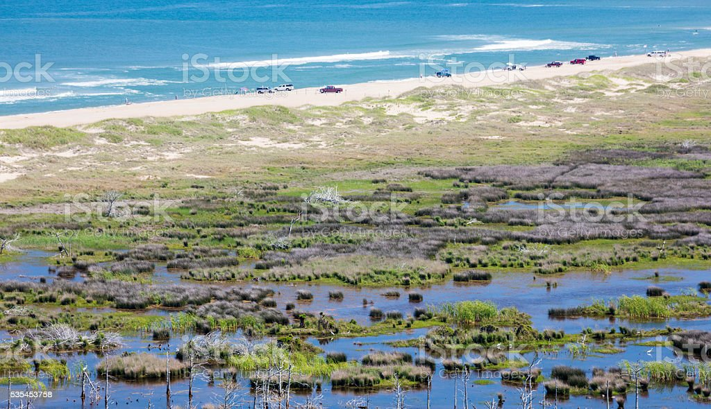 Beach and Marsh at Cape Hatteras with 4WD vehicles stock photo
