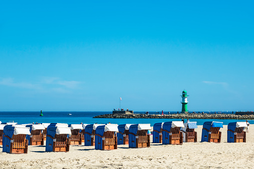 Beach and mole with blue sky in Warnemuende, Germany