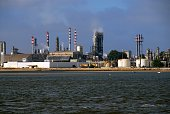 Lavradio, Barreiro, Setúbal District, Portugal: chemical industry factory by the beach, seen from the river -  manufacture of synthetic fibers using fossil fuels.
