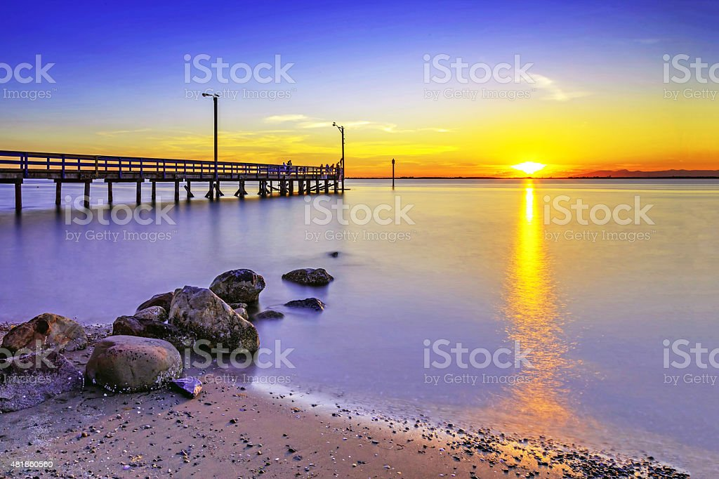 Beach and pier at sunset, Surrey, BC, Canada stock photo