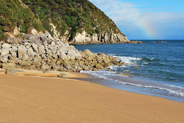 Beach and rainbow stock photo