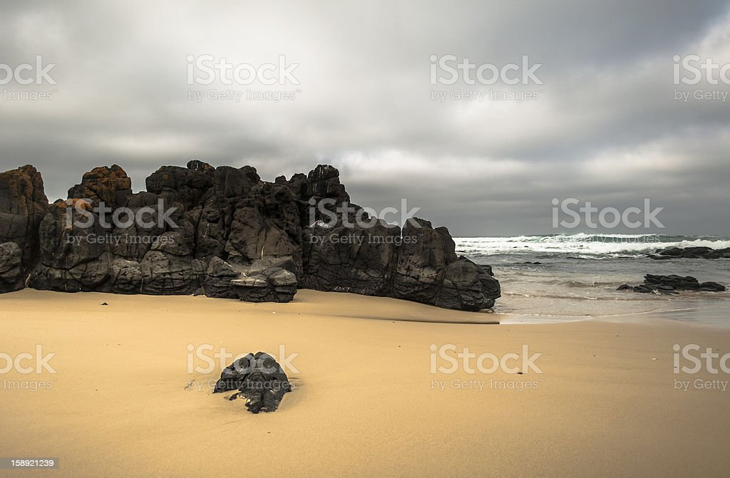 Beach and Rock Outcrop royalty-free stock photo