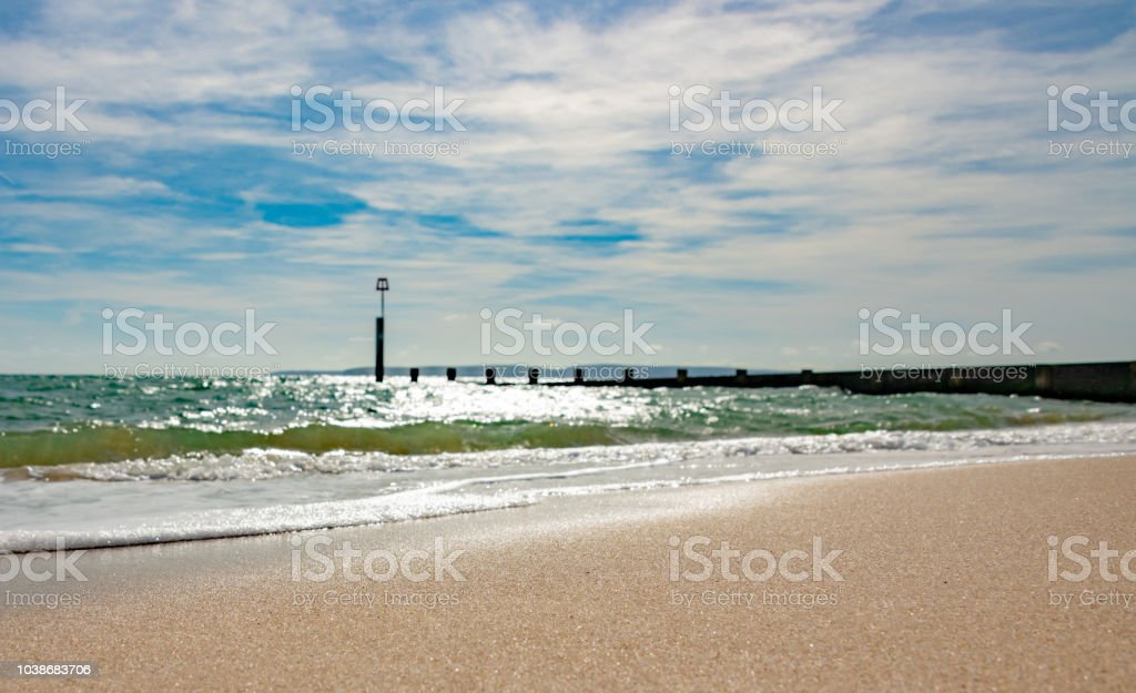Beach and sea defense groyne in Bournemouth stock photo