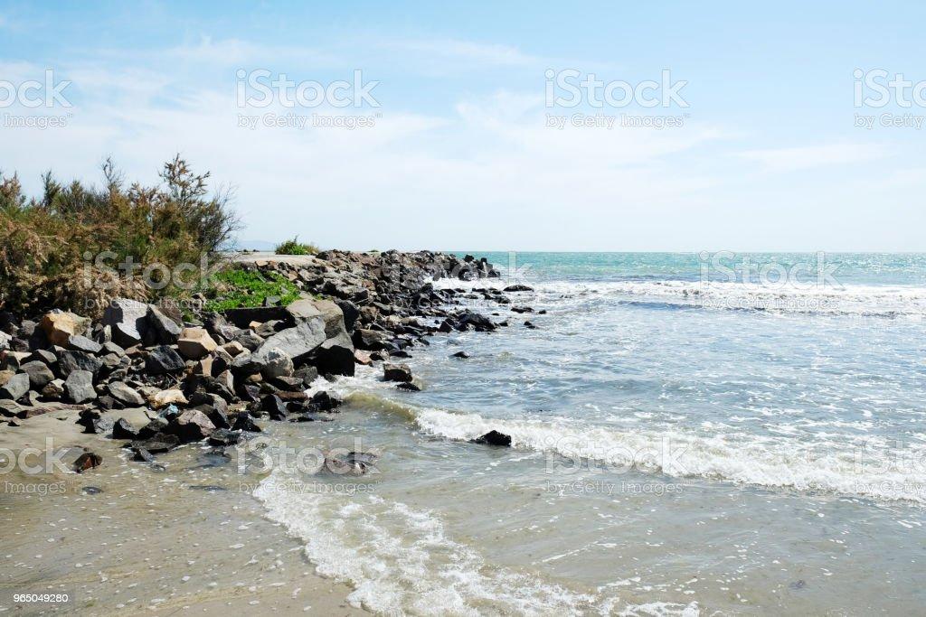 Beach and sea in bright sunlight zbiór zdjęć royalty-free