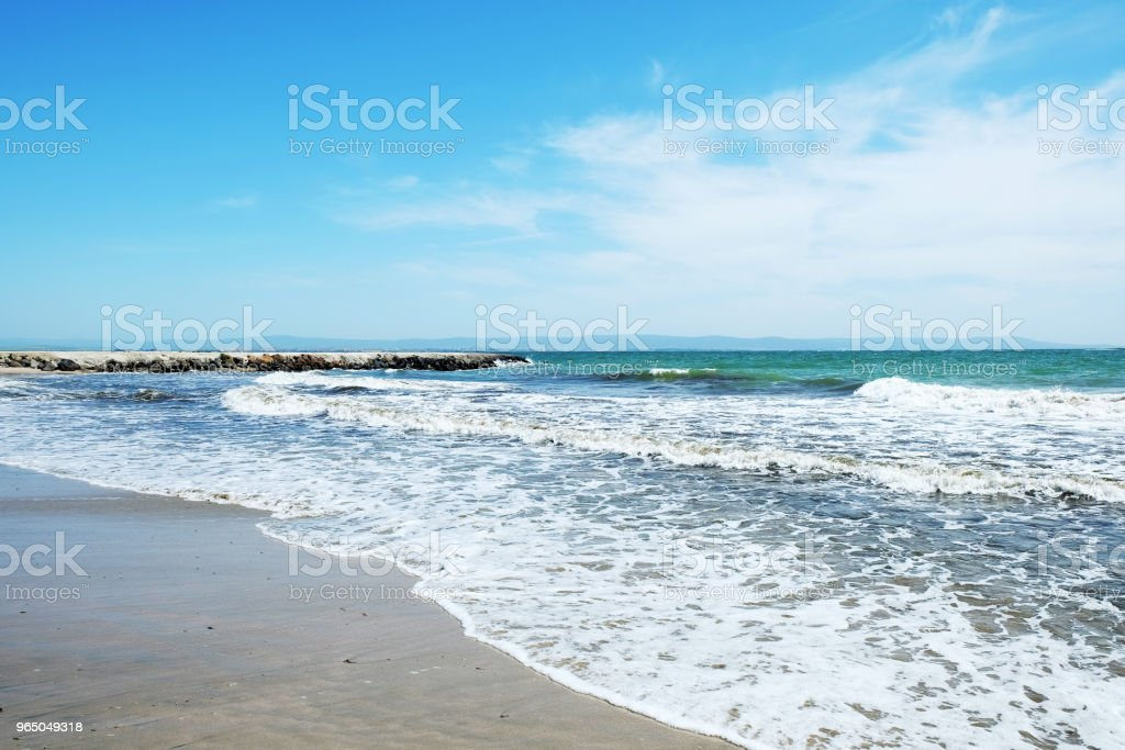 Beach and sea in bright sunlight royalty-free stock photo