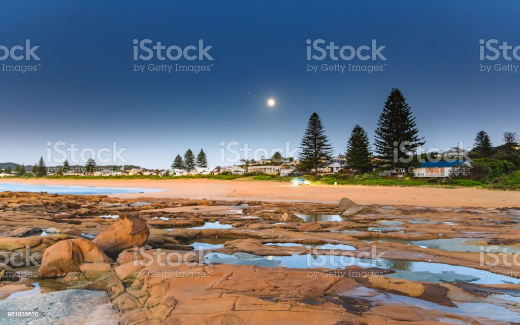 Beach and Shorescape with Moon stock photo