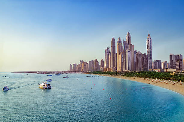 Beach and Skyline of Dubai Marina Picture of the Beach near Dubai Marina with view on the skyline. dubai stock pictures, royalty-free photos & images